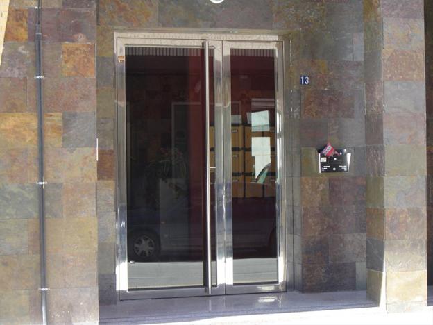 Acero inoxidable murcia for Puertas de acero inoxidable